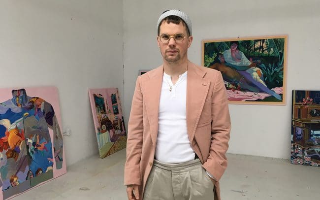 Portrait of Canadian painter Andy Dixon in his downtown LA studio in front of paintings.