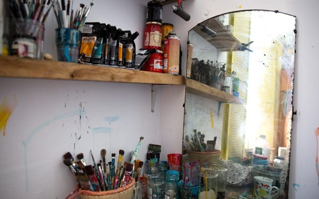 Picture of the interior of artist David Shillnglaw's studio in margate showing paints and paintbrushes