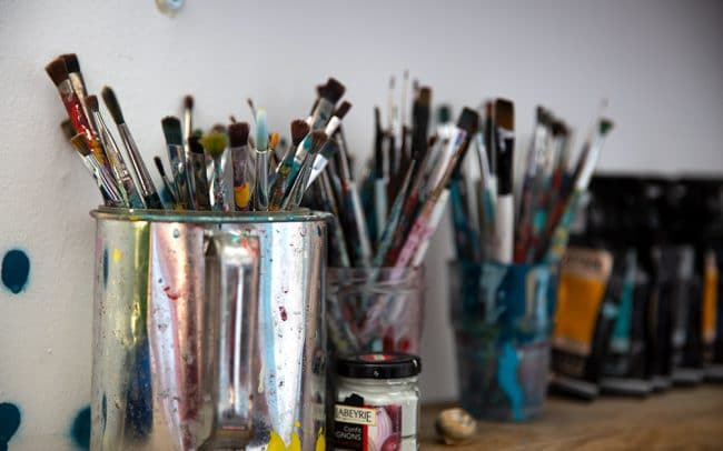 Picture of the interior of artist David Shillnglaw's studio in margate showing paint brushes