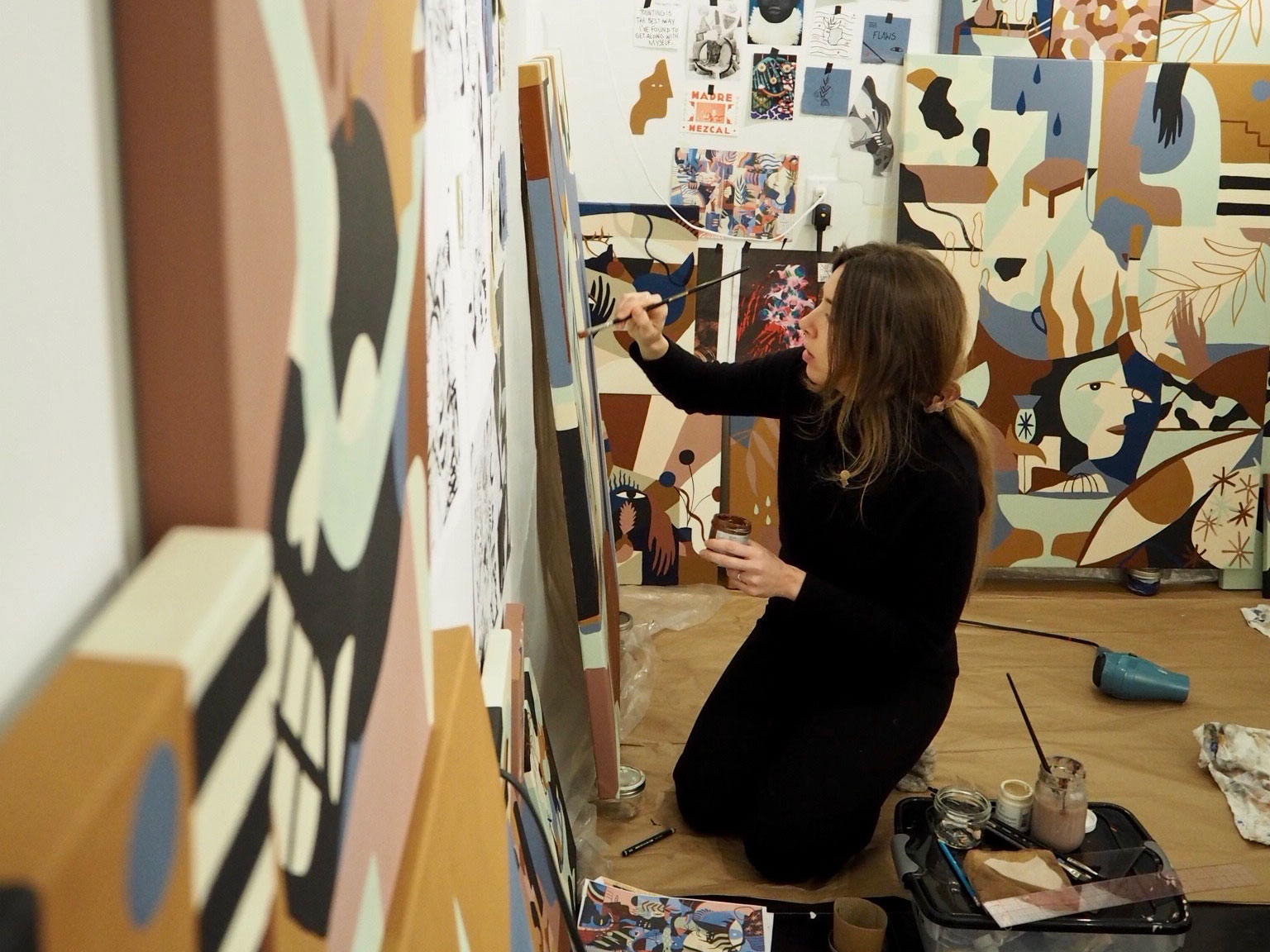 Portrait of French artist madi in her studio working on a canvas